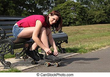 Fun time in sun beautiful girl putting on skates - Fun...