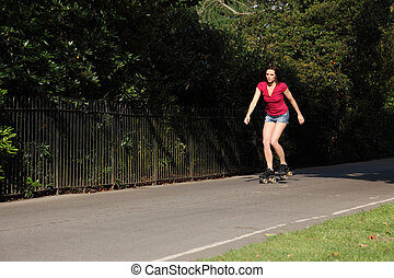 Roller skating summer leisure activity in the park - Leisure...