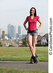 Beautiful woman roller skating in London England - Outdoor...