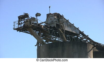 Cement Plant Loading Rocks Close Up - A close up shot of a...