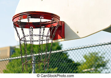 Inner city basketball basket - Old rusted chain link...