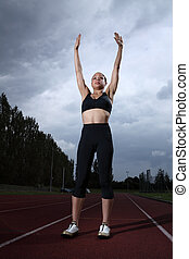 Success arms raised for female athlete on track