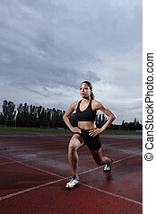 Lunge exercise for quadriceps by athlete on track - Warm up...