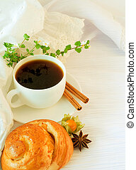 The French breakfast on lacy napkins, coffee and a roll