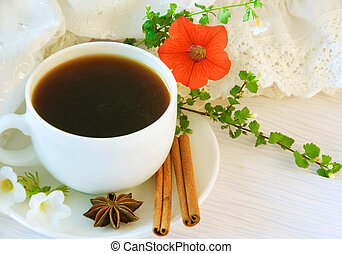 The French breakfast on lacy napkins, coffee and a flower