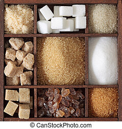 Various kinds of sugar in wooden box