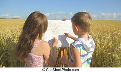 Young woman with little boy drawing - CLIP EDIT Young woman...