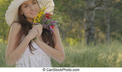 Young woman with bouquet of wild fl - CLIP EDIT Young woman...