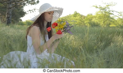 Young woman collecting flowers for - CLIP EDIT Young woman...