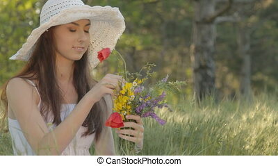 Young woman forming bouquet of wild - CLIP EDIT Young woman...