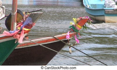 Asian Fishing Boats - Colorful ribbons flap in the breeze on...