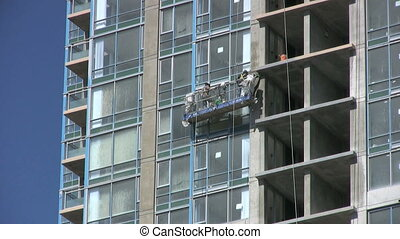 Construction Workers On Highrise