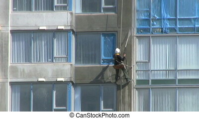 Worker Washing New Building - A close up shot of a worker...