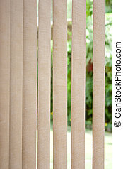 Vertical blinds in sunlight - White vertical blinds as...