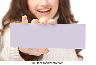 Young woman holding an empty billboard over white background...