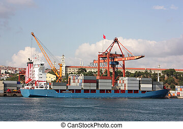 Large container ship in a dock at port - Side view