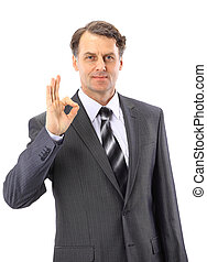 Young business man, in the suit, showing a sign ok