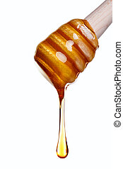 Honey dripping from a wooden dipper - Photo of Honey...