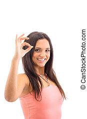 Portrait of a cute female showing an OK sign isolated over white background