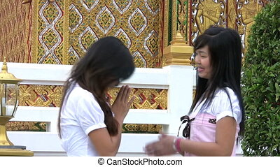 Asian Girls Meet And Greet - Two Thai girls meet up outside...