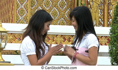 Asian Girls Talking And Laughing - Two Thai girls meet up...