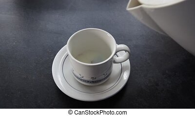 Teacup being filled. - Teacup being filled with boiling...