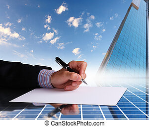 Businessman hand signing documents - Image of a businessman...