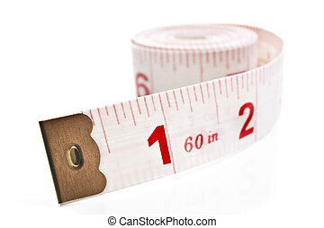 White and red tape measure on a white background with space...