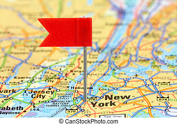 New York City Red flag pin on an old map showing travel...