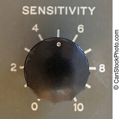 half sensitivity - old radio dial turned down to half its...
