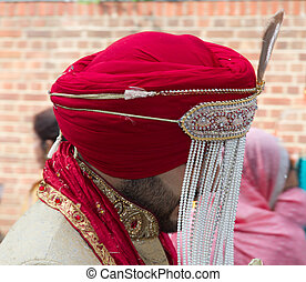 Traditional sikh groom with wedding turban