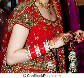 Indian bride closeup with henna hands and bangles
