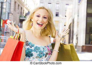 excited shopping woman - Excited shopping woman with bags.