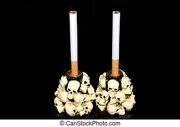 Smoking kills - Two white cigarettes in a candlestick...