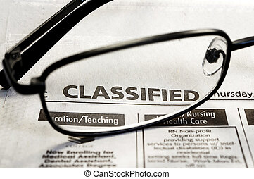 Job Hunting - Closeup of classified ads in newspaper with...