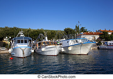 three fishing boats in a croatian harbour