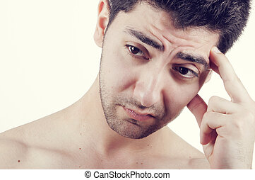 Worried young man - A worried young man thinking with his...