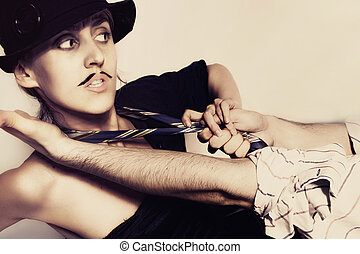 woman in a black hat and painted mustache - beautiful young...