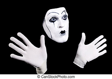 Mime face and hands in white gloves and a theatrical make-up...