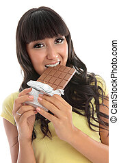 Beautiful girl eating a block of chocolate