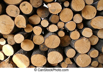wooden cut texture for background. Stacked timber logs fuel...