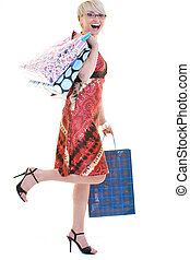 happy young adult women  shopping with colored bags