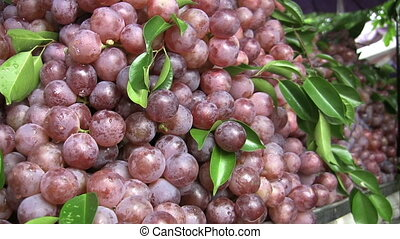 Fresh Grapes At The Market - Delicious fresh red grapes for...