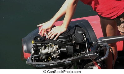 Fixing An Outboard Motor 2 - A woman tries to fix her broken...