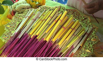 Bundling Incense Sticks - A lady bundles together incense...