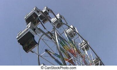 Ferris Wheel - Wide Shot - A ferris wheel ride at a local...