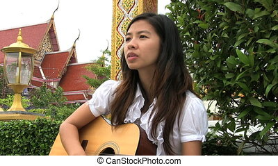 Asian Girl Sings And Worships - A young Thai female...