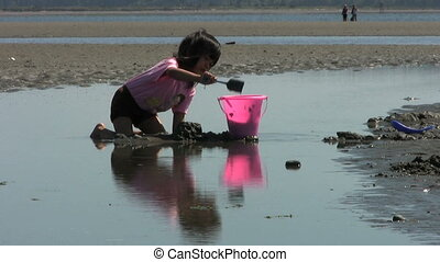 Girl Filling Up Her Bucket - A close up shot of a cute...