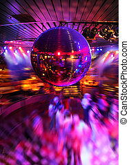 Dancing under disco mirror ball - People dancing under...