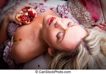 Portrait of beautiful lying blonde woman with closed eyes...